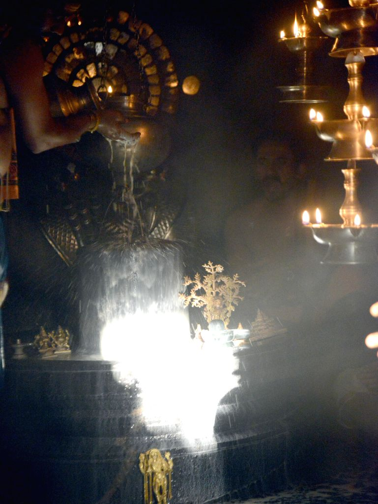 Sun rays fall on Shiva linga on Makara Sankranti at Gavi Gangadhareshwara Temple which was cut out of a monolithic rock probably in the 9th century in Bengaluru on Jan.14, 2015.