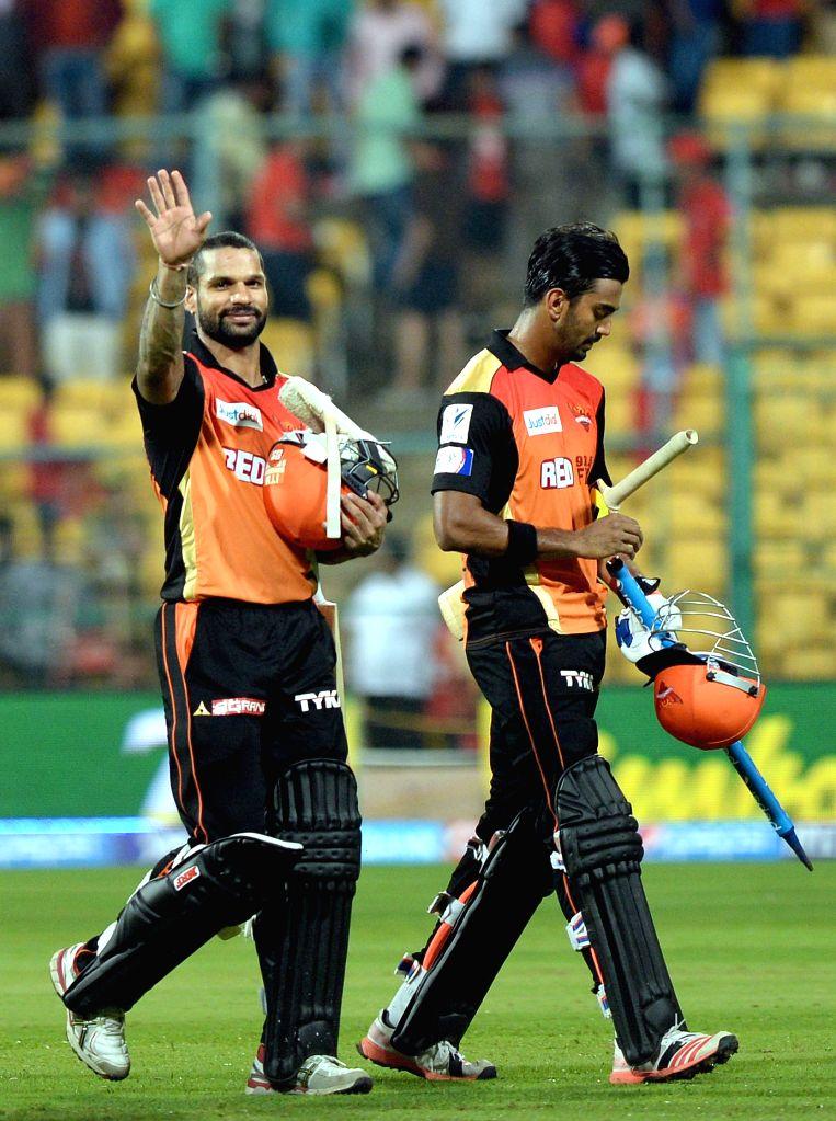 Sunrisers Hyderabad batsmen Shikhar Dhawan and Lokesh Rahul after winning the IPL-2015 match against Royal Challengers Bangalore at M Chinnaswamy Stadium, in Bengaluru, on April 13, 2015. - Shikhar Dhawan and Lokesh Rahul