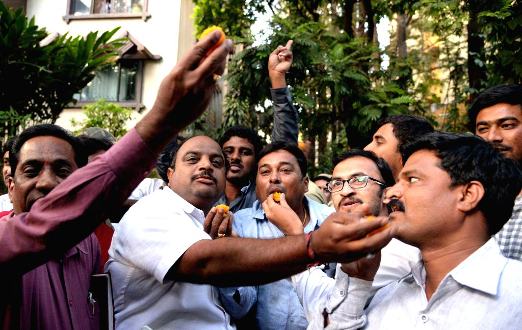 Supporters of Karnataka's former BJP minister and mining baron G. Janardhana Reddy distribute sweets after the Supreme Court granted him conditional bail in graft cases related to the ... - G. Janardhana Reddy