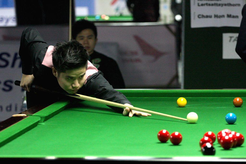 Thai player Kritsanut Lertsattayathorn in action during IBSF World Snooker Championships at Kanteerava Stadium, in Bengaluru on Nov. 27, 2014.