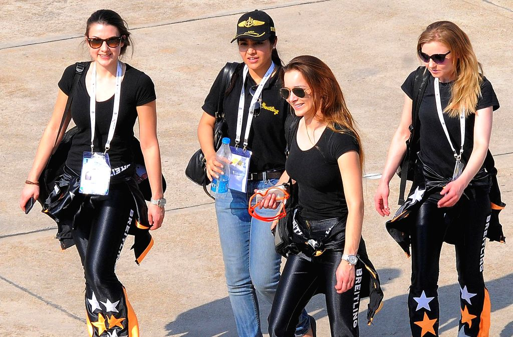The Breitling Wingwalkers - a British aerobatics and wingwalking team at the Aero India Show 2015, at Yelahanka Air-force Station, in Bengaluru on Feb 20, 2015.