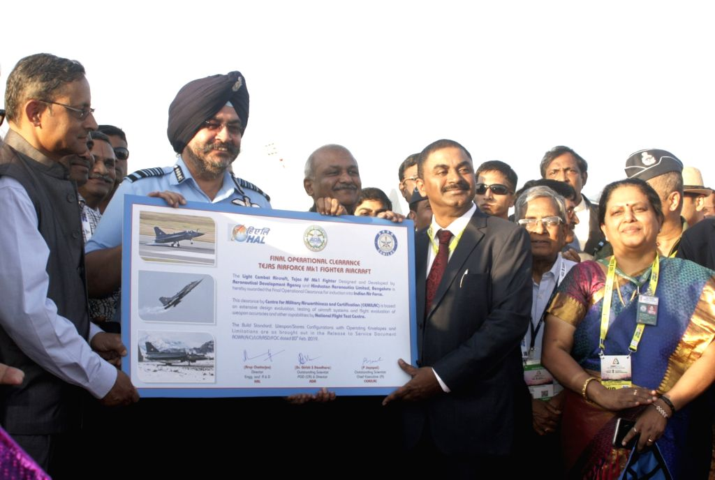 Bengaluru: The Centre for Military Airworthiness and Certification (Cemilac) Chief Executive P. Jayapal hands over the 'release-to-service' documents to the Chief of Air Staff Air Marshal B.S. Dhanoa at the Aero India air show in Bengaluru on Feb 20,