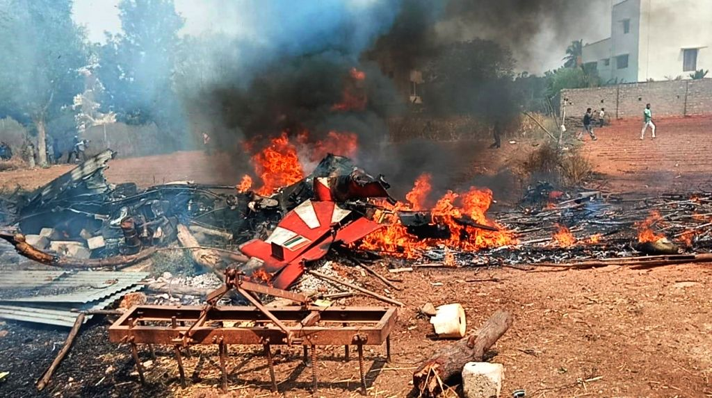 Bengaluru: The debris of two Hawk MK 132 aircraft of Indian Air Force's Surya Kiran display team that crashed after a mid-air collision while rehearsing for upcoming  'Aero India 2019' air show near the Yelahanka airbase, in Bengaluru on Feb 19, 2019