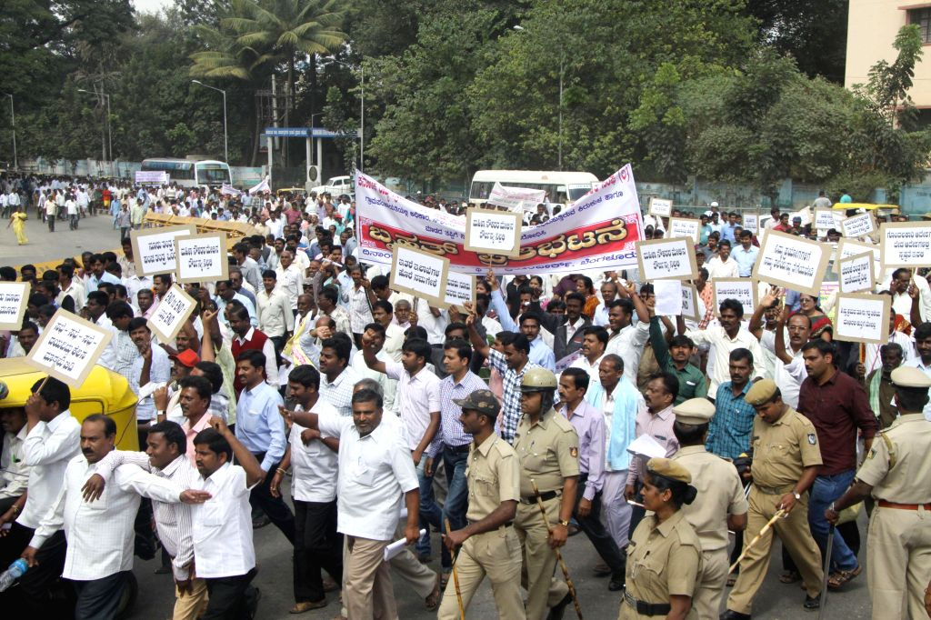 The employees of Karnataka rural development and Panchayat  Raj department participate in a demonstration to press for their demands, in Bengaluru on Dec 17, 2014.