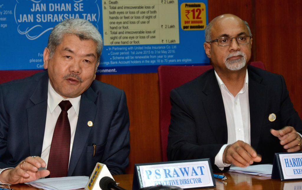 The Executive Directors of Canara Bank RS Rawat and Harideesh Kumar address a press conference in Bengaluru, on May 7, 2015. - Harideesh Kumar