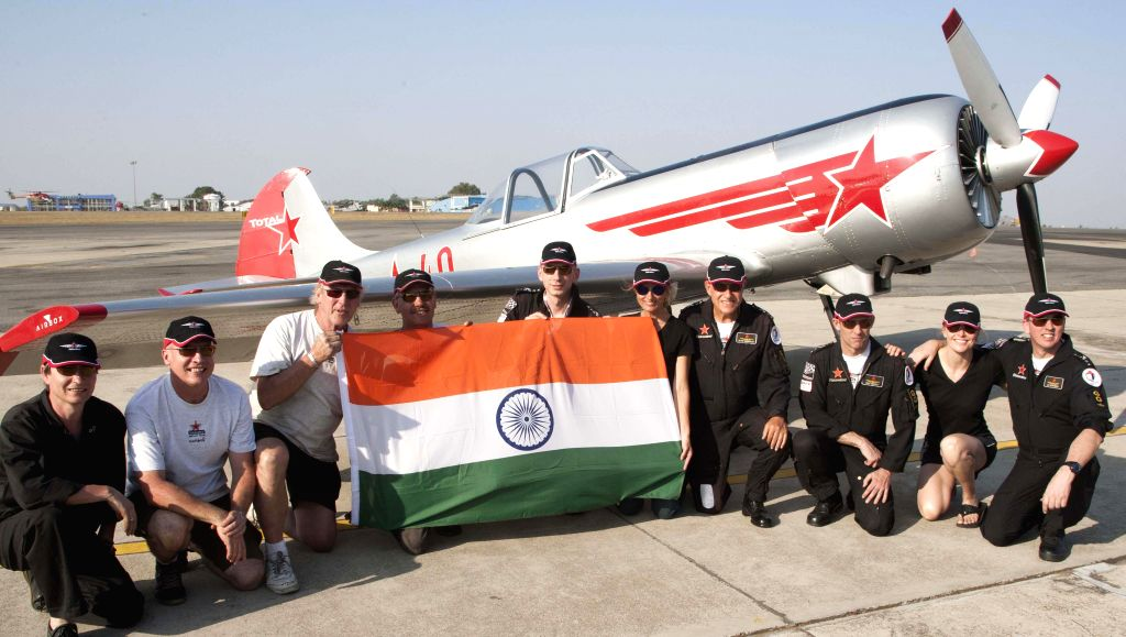 The massage of Fraternity from the UK`s finest Russian Aerobatic Display Team during AERO show 2015 rehearsal at Yelhanka airforce station, in Bengaluru on Feb 16, 2015.