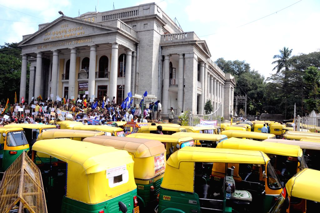 The members of Adarsha Auto And Taxi Drivers Union stage a protest against police atrocity on auto drivers, in Bengaluru on Dec 30, 2014.