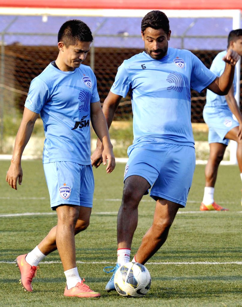 The players of Bengaluru FC in action during a practice session ahead of an I league match against Mumbai FC in Bengaluru on April 6, 2015.