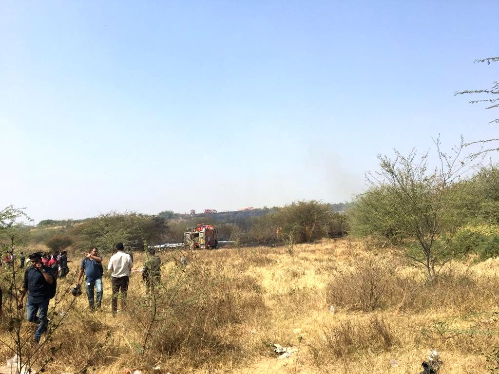 Bengaluru: The site where an IAF aircraft crashed in Yemalur, a village near Bengaluru on Feb 1, 2019. (Photo: IANS)