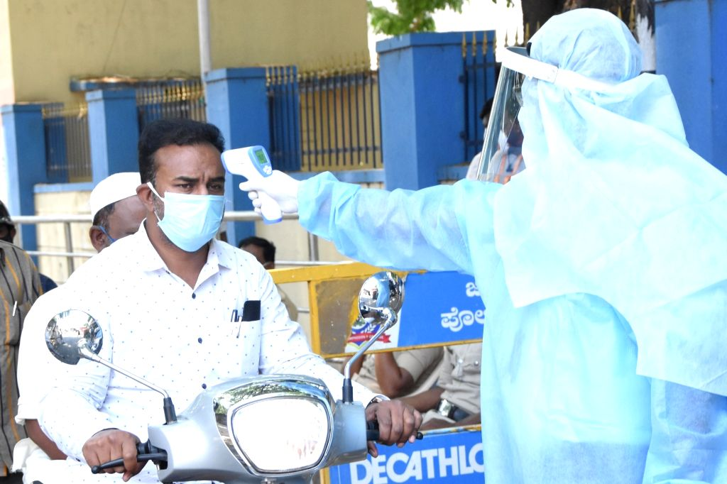 Bengaluru: Thermal screening of the residents of Padarayanapura ward underway as the ward was seal-down by BBMP due to Coronavirus hot-spot, during the nationwide lockdown announced by Prime Minister Narendra Modi as a precautionary measure to contai - Narendra Modi