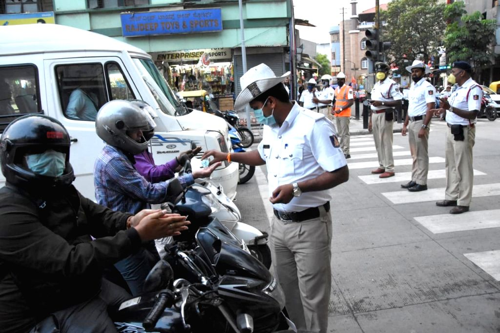 Bengaluru Traffic police personnel awareness campaign for public using sanitation and hand wash COVID-19 (coronavirus) outbreak in Bengaluru on March 20, 2020