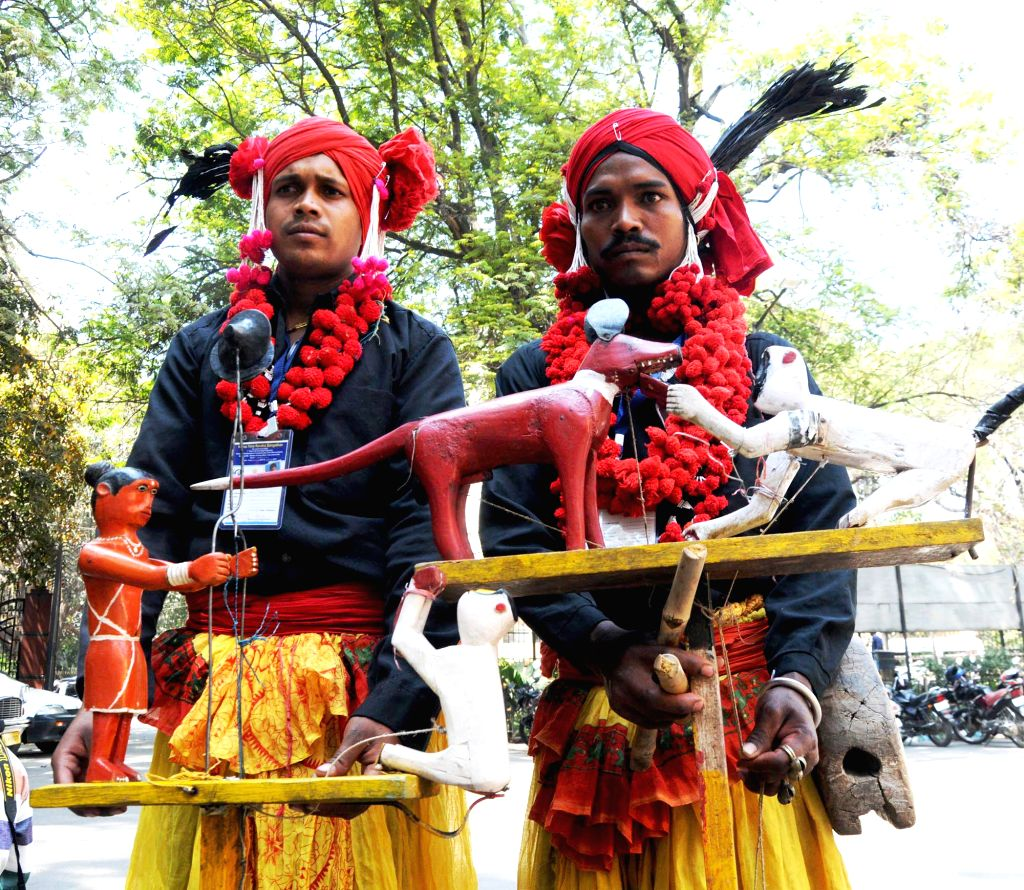 Tribal artists demonstrate their cultural heritage during the inauguration of 7th Tribal Youth Exchange Programme in Bengaluru on Feb 22, 2015.