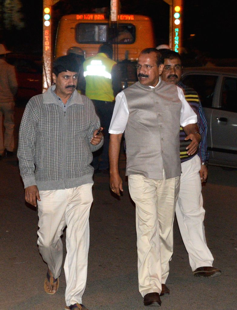 Union Law Minister D. V. Sadananda Gowda visits the site of the low intensity bomb blast that rocked Church Street area of Bengaluru on Dec 28, 2014. Two people, including a woman, were ... - D. V. Sadananda Gowda