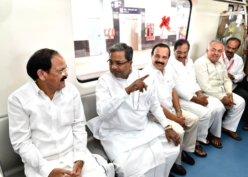 Union Ministers M. Venkaiah Naidu, D. V. Sadananda Gowda and Karnataka Chief Minister Siddaramaiah travel in a metro coach on the  Namma Metro Line in Bangalore on May 1, 2015. - Karnataka Chief Minister Siddaramaiah, M. Venkaiah Naidu and D. V. Sadananda Gowda