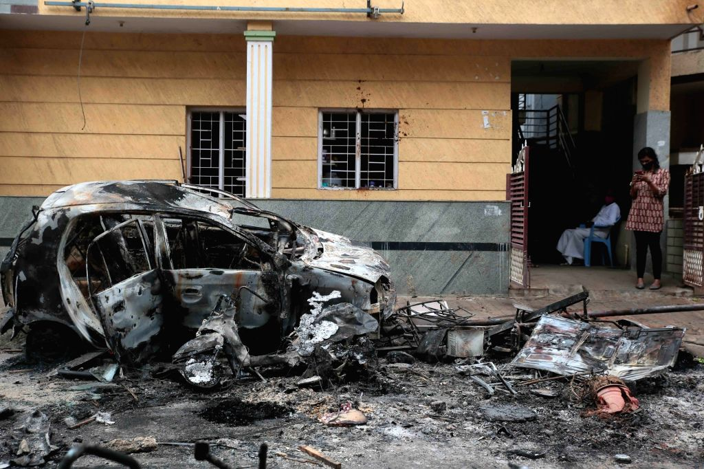Bengaluru: Vehicles burnt by an irate mob during violence that erupted late on Tuesday night that resulted after an inflammatory social media post by Congress legislator Akanda Srinivas Murthy's relative, in parts of East Bengaluru, on Aug 12, 2020.