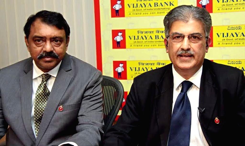 :Bengaluru: Vijaya Bank CEO and MD Kishore Kumar Sansi with Executive Directors BS Rama Rao during a press conference in Bengaluru on Nov. 6, 2015. (Photo: IANS).