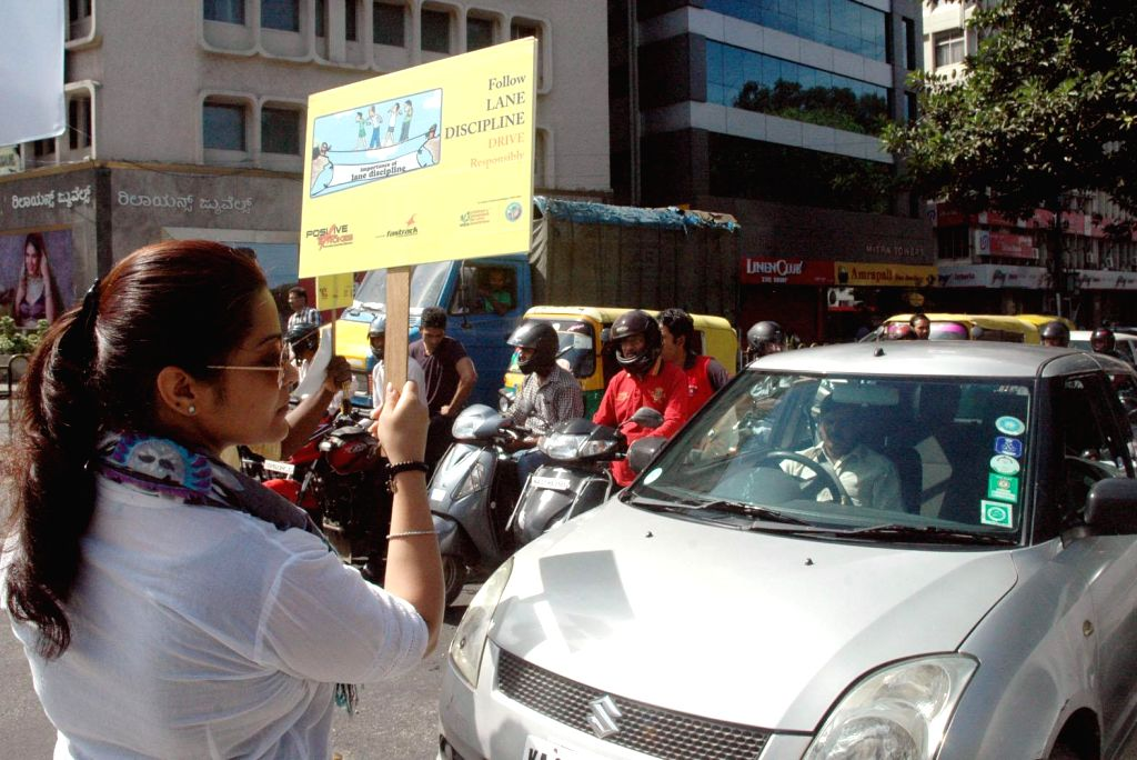 Volunteers participate in `Positive Strokes`- a road safety awareness campaign in Bengaluru on 14 March 2015.