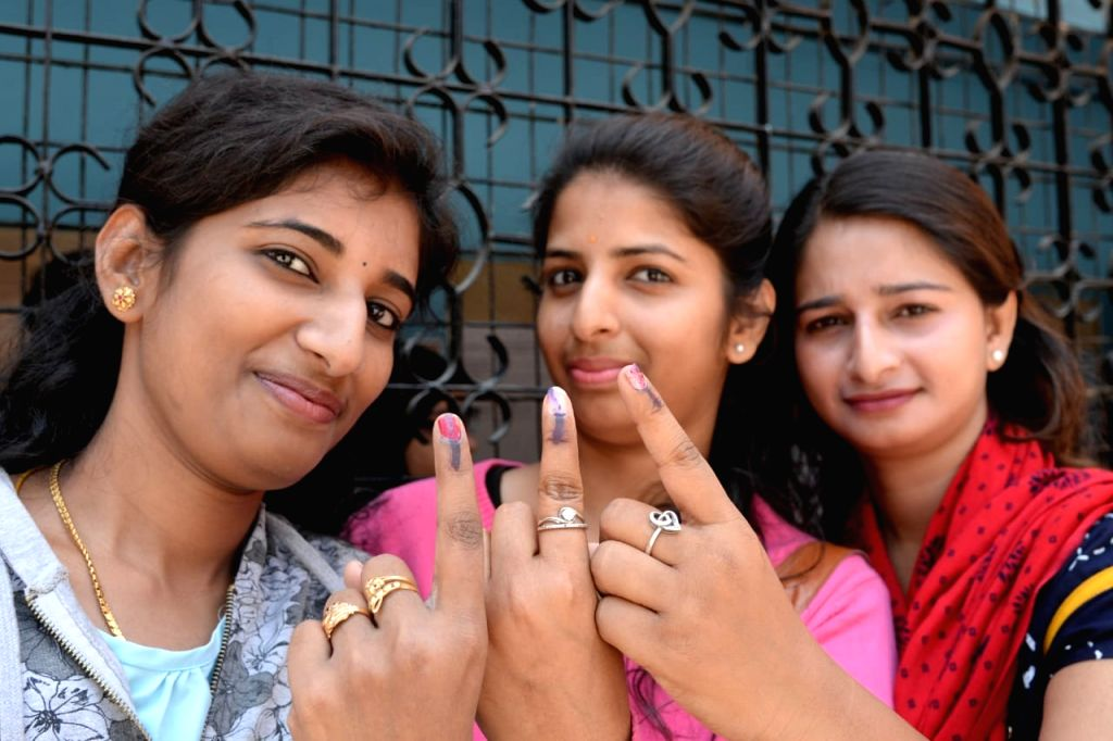 Bengaluru: Women show their fingers marked with phosphoric ink after casting votes for the second phase of 2019 Lok Sabha elections, in Bengaluru on April 18, 2019. (Photo: IANS)