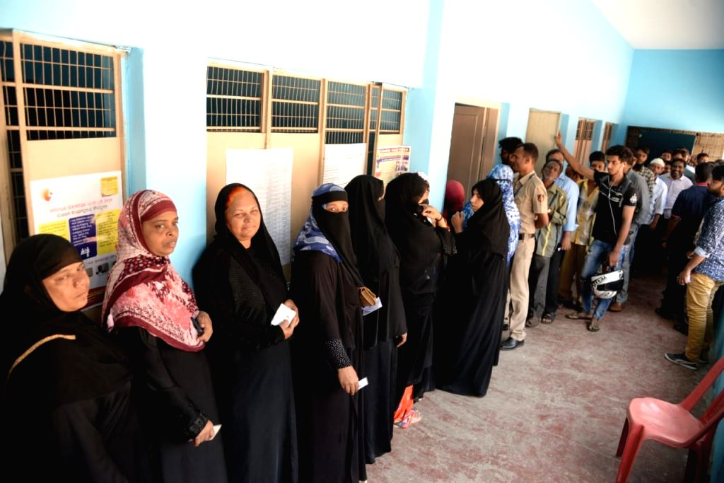 Bengaluru: Women wait in a queue to cast their votes for the second phase of 2019 Lok Sabha elections, in Bengaluru on April 18, 2019. (Photo: IANS)