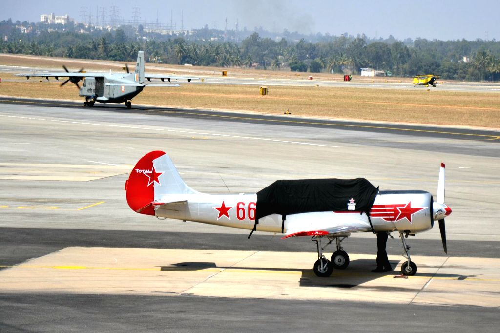 Yakovlevs Aerobatic aircraft during the rehearsal for the Aero India show 2015 at Yelhanaka Airforce Station, in Bengaluru on Feb 14, 2015.