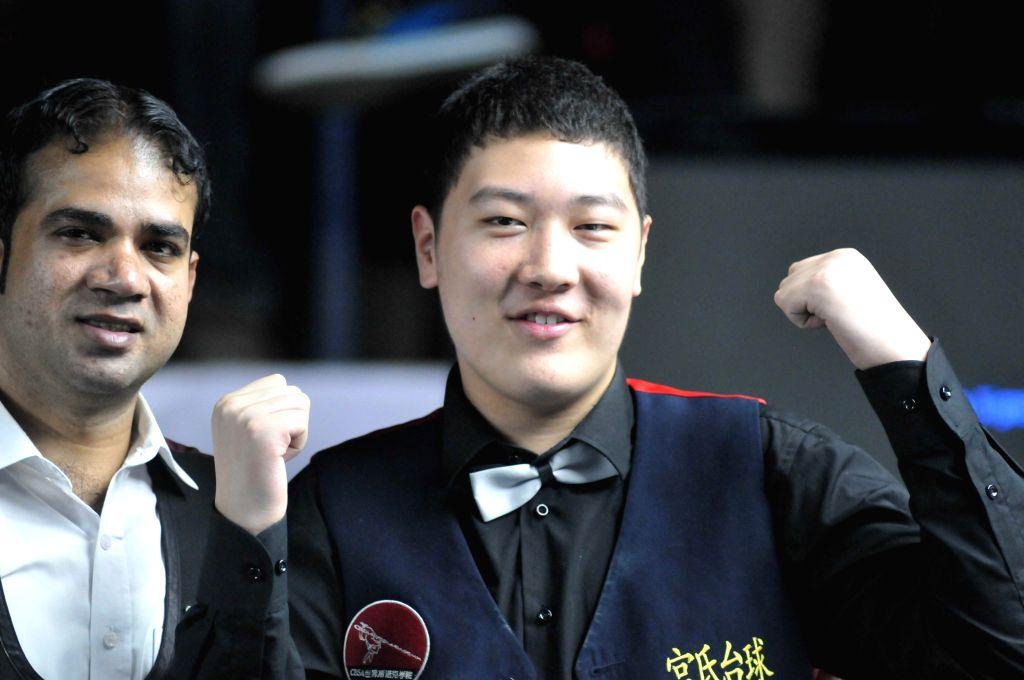 Yan Bingtao (Mens) of China during the prize distribution ceremony of IBSF World Snooker Championships at Kanteerava Stadium, in Bengaluru on Nov. 29, 2014.