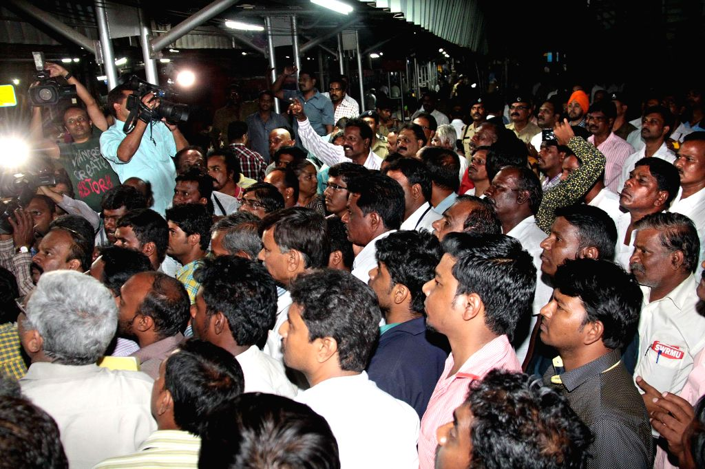 Commuters waiting at Bengauluru City Railway Station during Bengaluru City Railway staffs and employees protest against arrest of Railway officer Pandurangan, in Bangalore on April 7, ...