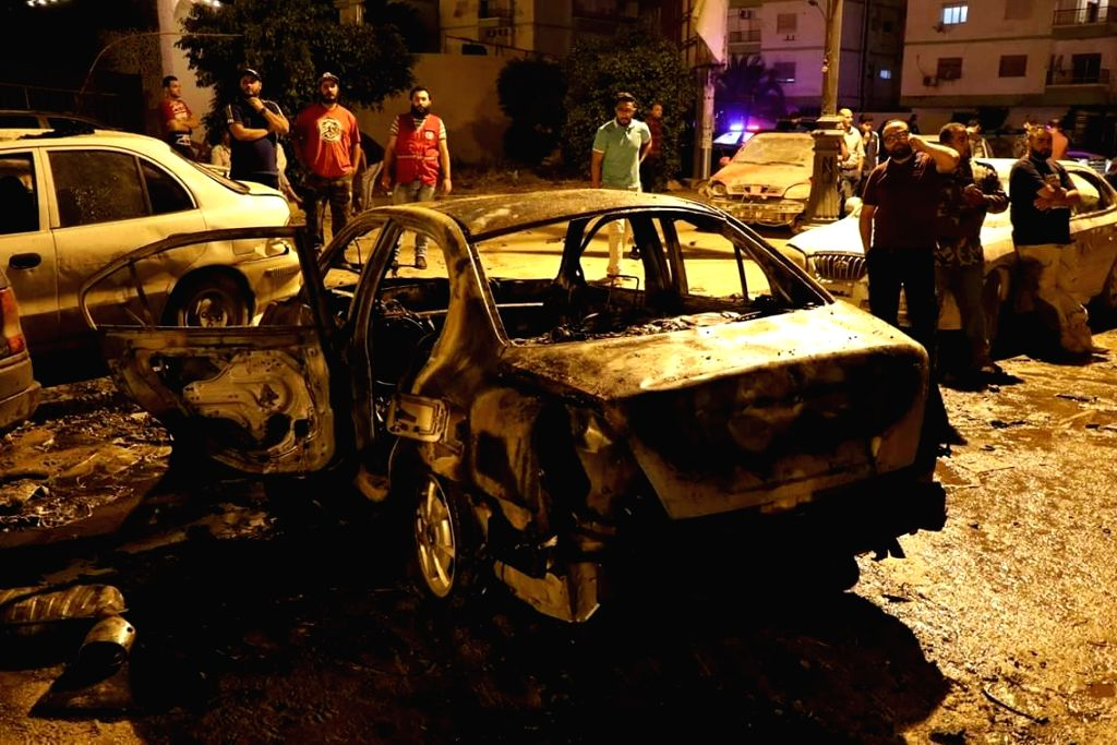 BENGHAZI, May 25, 2018 - People gather around the destoryed vehicles in the eastern Libyan city of Benghazi, Libya, on May 25, 2018. A car bomb explosion killed six and injured more than 20 people in ...