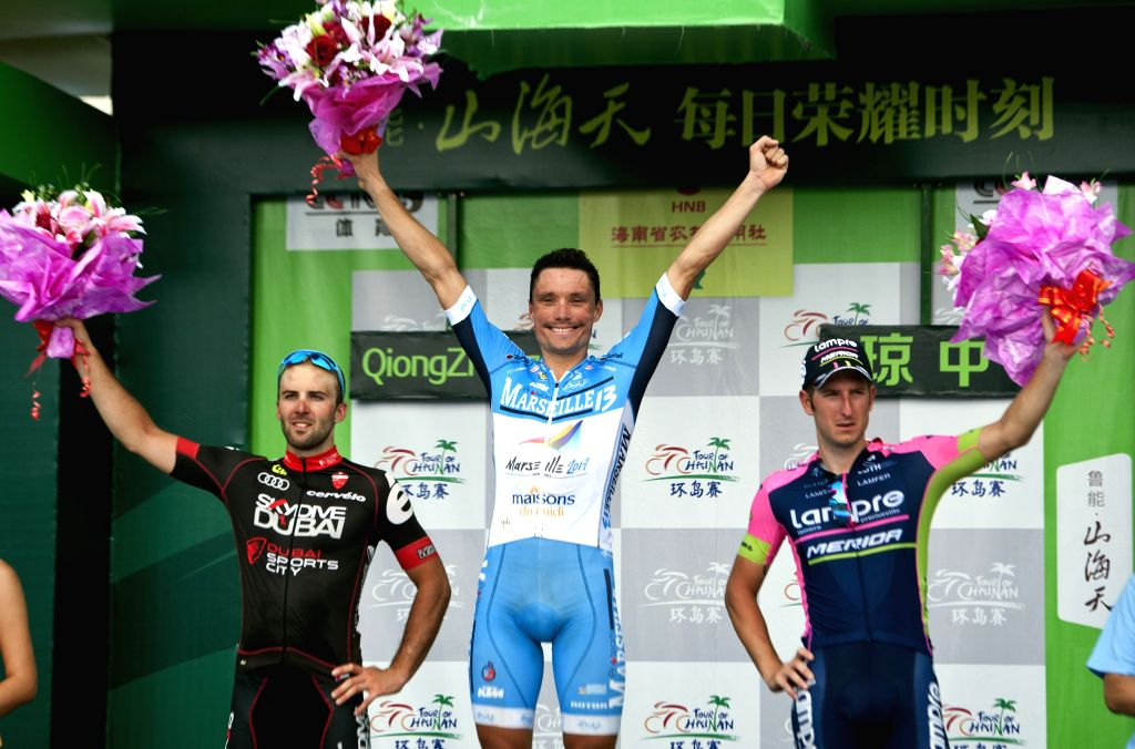 Benjamin Giraud(C) from Team Marseille-13-Kym reacts during the awarding ceremony of the 5th stage of the 2015 Tour of Hainan International Road Cycling Race in ...
