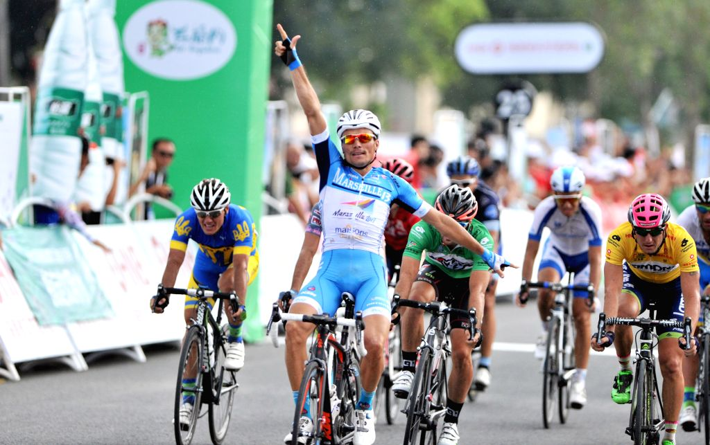 Benjamin Giraud  celebrates while crossing the finish line in the 5th stage of the 2015 Tour of Hainan International Road Cycling Race in Qiongzhong, south ...
