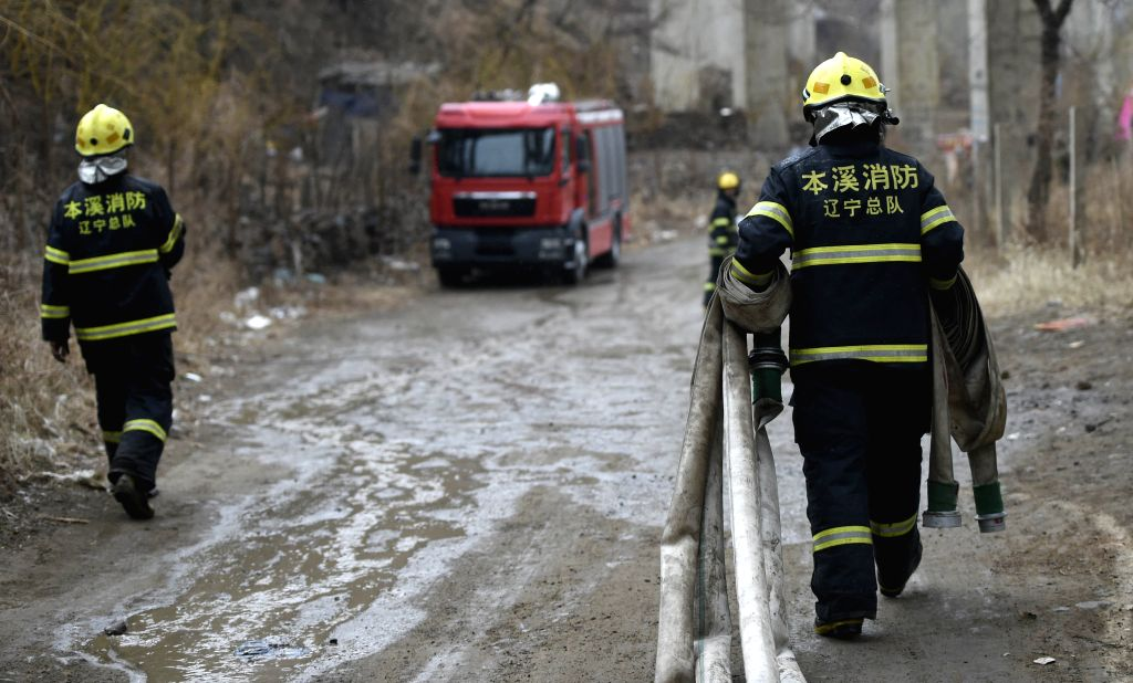 BENXI, April 12, 2016 - Firemen walk down the mountain after putting out a fire on Xiaosonggou Mountain in Benxi City, northeast China's Liaoning Province, April 12, 2016. Several houses were damaged ...