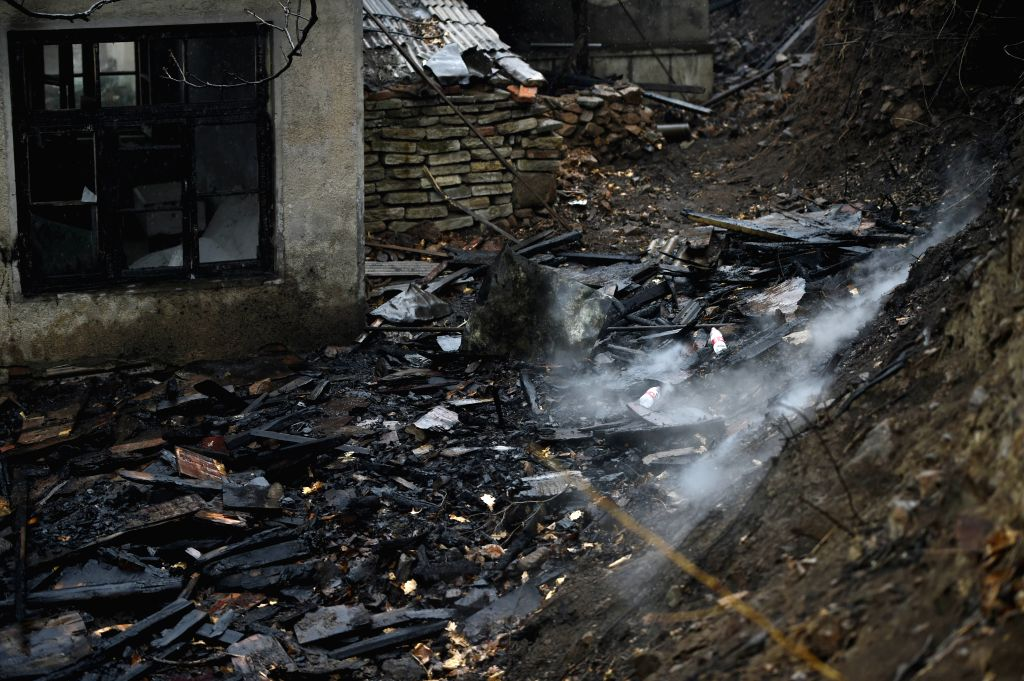 BENXI, April 12, 2016 - Photo taken on April 12, 2016 shows the remains at a villager's house damaged by a fire on Xiaosonggou Mountain in Benxi City, northeast China's Liaoning Province. Several ...