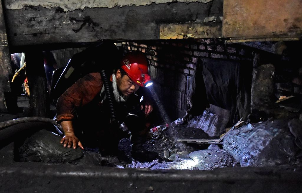 BENXI, July 5, 2016 - A rescuer works at the site of a coal mine in which a fire broke out in Benxi City, northeast China's Liaoning Province, July 5, 2016. The mine in Benxi City caught fire early ...