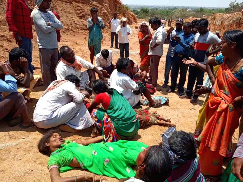 Bereaved family members of those labourers, who was killed after a mound of clay fell on them during digging works in Telangana's Narayanpet district, on April 10, 2019.
