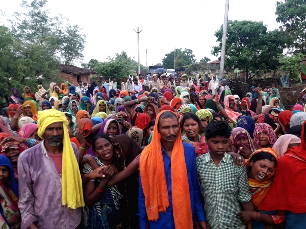 Bereaved relatives of the persons killed in mass murder in Ubhbha village of Ghoraval tehsil in Sonbhadra district of Uttar Pradesh on July 18, 2019. Police have arrested 24 people in ...