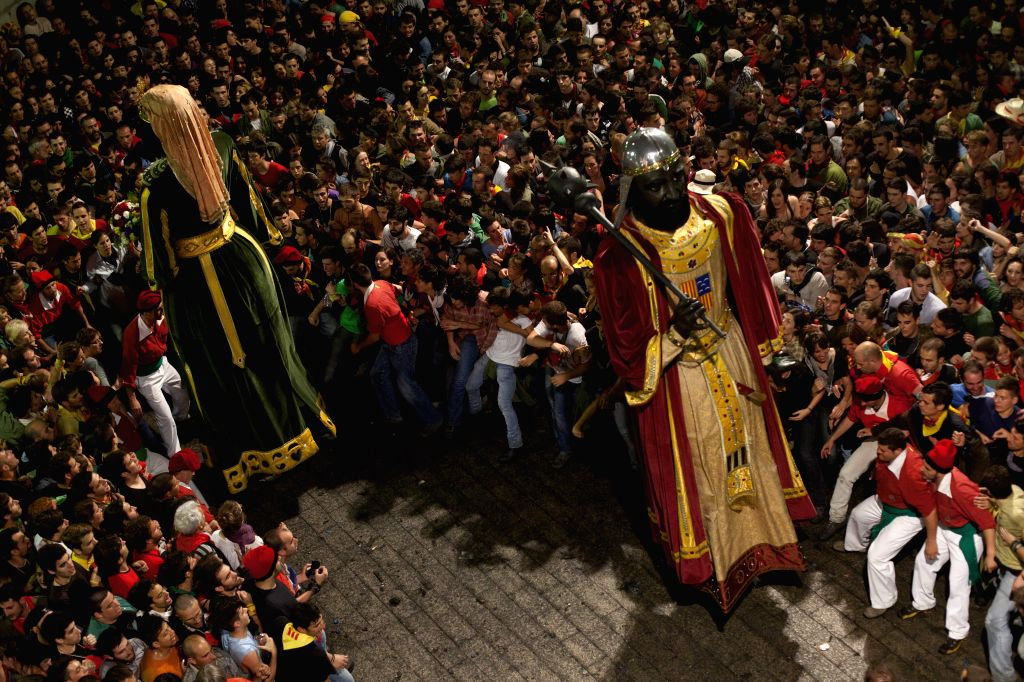 Revelers take part in the traditional party La Patum in Berga, Spain, June 19, 2014. The La Patum is a traditional festival that is celebrated each year in Berga. It .