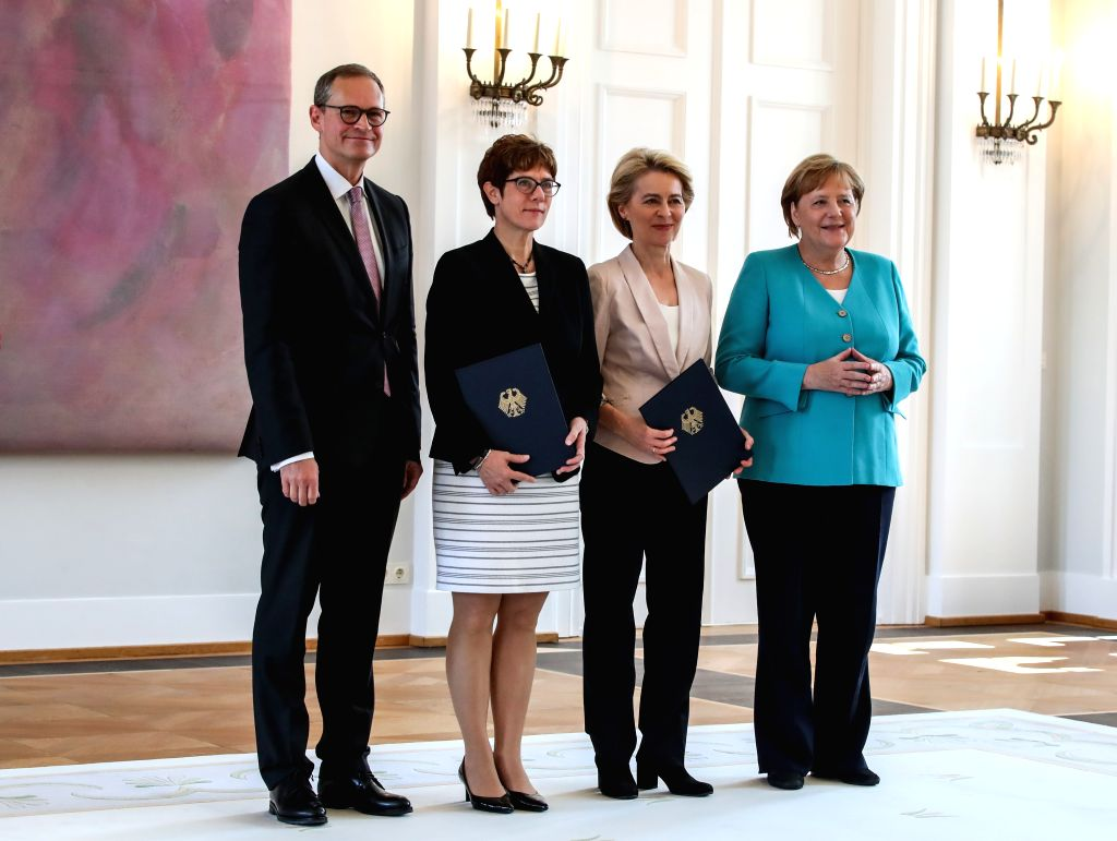 BERLIIN, July 17, 2019 - (From R to L) German Chancellor Angela Merkel, outgoing German Defense Minister Ursula von der Leyen, incoming German Defense Minister Annegret Kramp-Karrenbauer, and Michael ... - Ursula