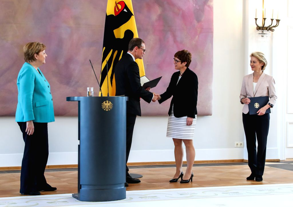 BERLIIN, July 17, 2019 - Michael Mueller (2nd L), deputy president of the Bundesrat and Berlin's head of government, shakes hands with incoming German Defense Minister Annegret Kramp-Karrenbauer (2nd ... - Annegret Kramp-Karrenbauer