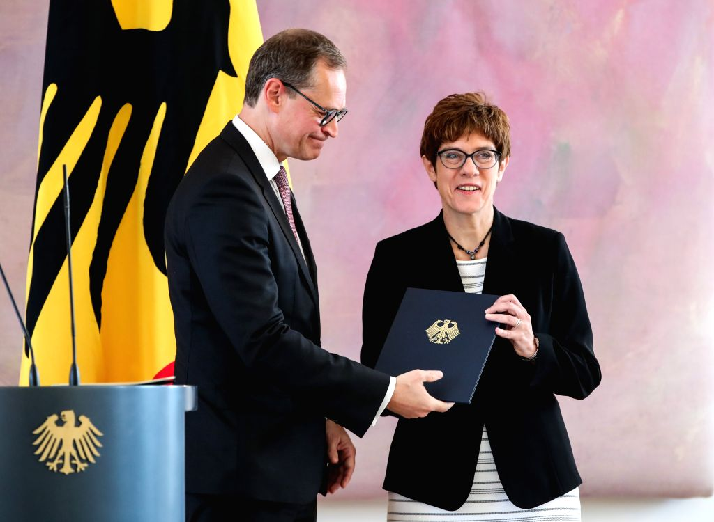BERLIIN, July 17, 2019 - Michael Mueller (L), deputy president of the Bundesrat and Berlin's head of government, hands over the appointment certificate to incoming German Defense Minister Annegret ... - Annegret Kramp-Karrenbauer
