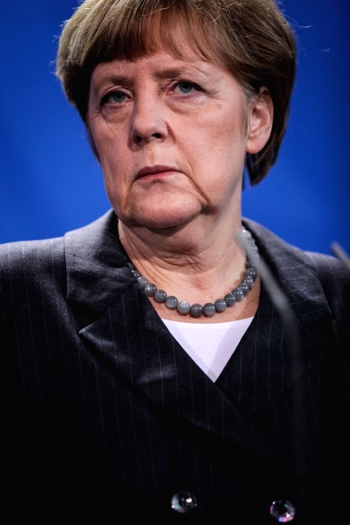 German Chancellor Angela Merkel attends the press conference after meeting with Ukrainian Prime Minister Arseniy Yatsenyuk (not in picture) at the Chancellory, ... - Arseniy Yatsenyuk