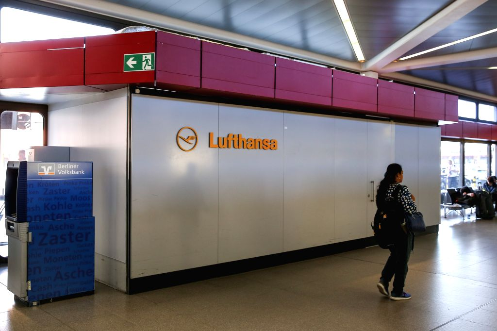 BERLIN, April 10, 2018 - A passenger walks past an office of Lufthansa at Tegel International Airport in Berlin, capital of Germany, on April 10, 2018. German airline giant Lufthansa cancelled more ...