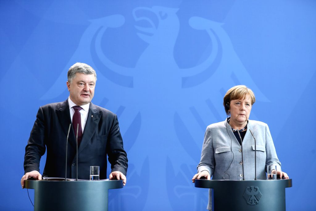 BERLIN, April 10, 2018 - German Chancellor Angela Merkel (R) and visiting Ukrainian President Petro Poroshenko attend a joint press conference at German Chancellery in Berlin, capital of Germany, on ...
