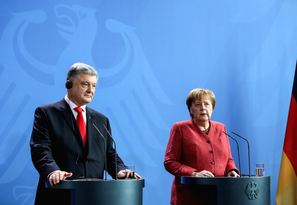 BERLIN, April 12, 2019 - German Chancellor Angela Merkel (R) and visiting Ukrainian President Petro Poroshenko attend a joint press conference at the German Chancellery in Berlin, capital of Germany, ...
