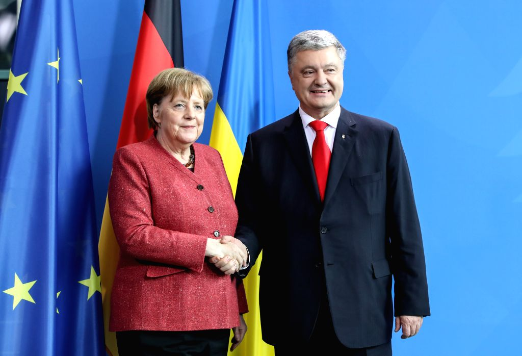 BERLIN, April 12, 2019 - German Chancellor Angela Merkel (L) shakes hands with visiting Ukrainian President Petro Poroshenko after a joint press conference at the German Chancellery in Berlin, ...