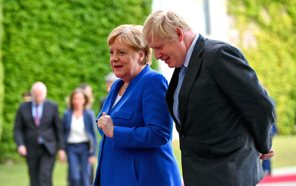 BERLIN, Aug. 21, 2019 (Xinhua) -- German Chancellor Angela Merkel (L) talks with visiting British Prime Minister Boris Johnson in Berlin, Germany, on Aug. 21, 2019. Angela Merkel and Boris Johnson on Wednesday reiterated the Brexit with a deal, but w - Boris Johnson