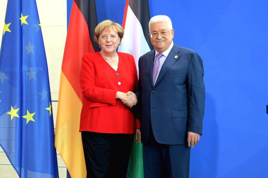 BERLIN, Aug. 29, 2019 - Palestinian President Mahmoud Abbas (R) shakes hands with German Chancellor Angela Merkel in Berlin, Germany, Aug. 29, 2019.