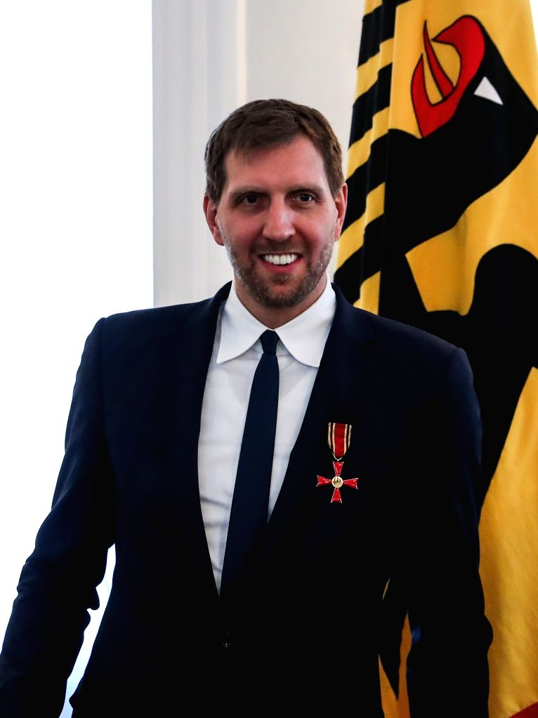 BERLIN, Dec. 4, 2019 - Former German basketball player Dirk Nowitzki reacts after being awarded the Order of Merit of the Federal Republic of Germany at the Bellevue Palace in Berlin, capital of ...
