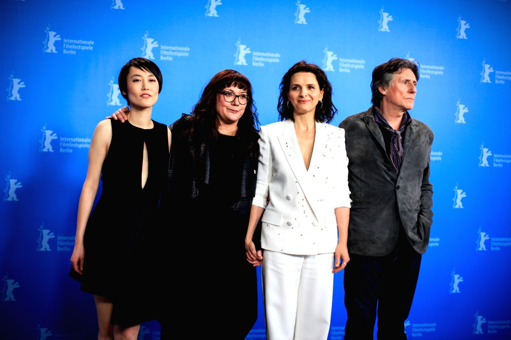 "Director Isabel Coixet (2nd, L) and her crew pose for photos during a photo call for the promotion of the movie ""Nobody Wants the Night"" at the 65th ..."