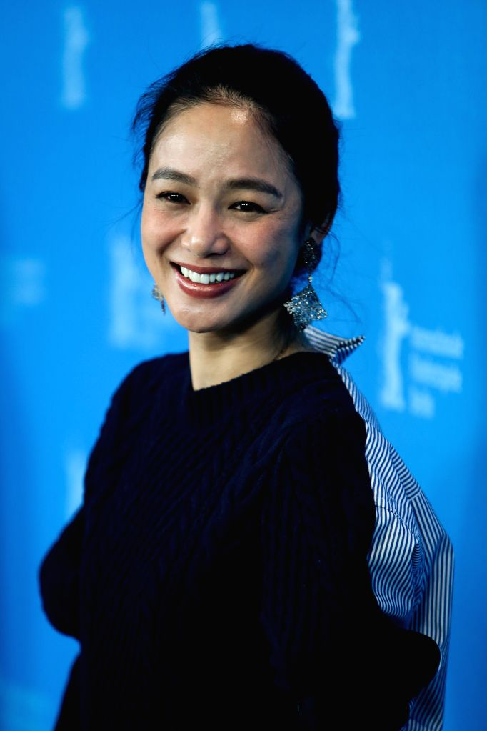 """Zhou Yun poses for photos during a photocall for the promotion of the movie """"Gone With The Bullets"""" (Yi Bu Zhi Yao) at the 65th Berlinale International ..."""