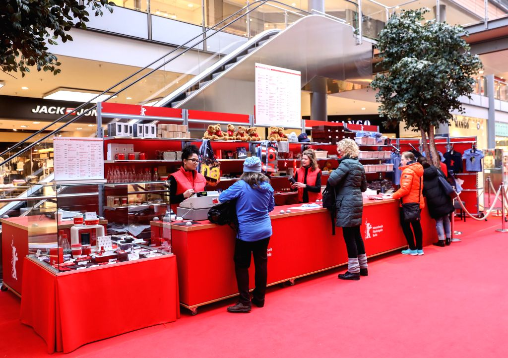 BERLIN, Feb. 14, 2018 - People select souvenirs of the Berlin International Film Festival in a shopping mall in Berlin, capital of Germany, on Feb. 14, 2018. The 68th Berlin International Film ...