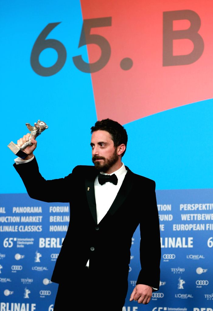 """Director Pablo Larrain holds his Silver Bear Grand Jury Prize for his film """"El Club"""" during a  news conference after the awarding ceremony of the 65th ..."""